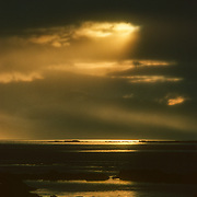 Dramatic sunset over Chatham Strait, Southeast Alaska, USA.