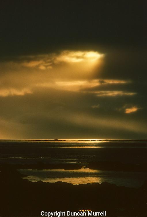 Dramatic sunset over Chatham Strait, Southeast Alaska, USA.