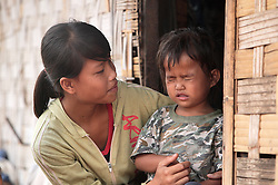 Lang, now 3.5 years old and her elder, unnamed sister.<br /> Santhong Disrict Vientiane Municipality, Lao PDR.