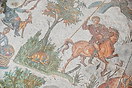 Hunter on horseback  about to spear a crouching hare From the Room of The Small Hunt, no 25 - Roman mosaics at the Villa Romana del Casale which containis the richest, largest and most complex collection of Roman mosaics in the world, circa the first quarter of the 4th century AD. Sicily, Italy. A UNESCO World Heritage Site. .<br /> <br /> If you prefer to buy from our ALAMY PHOTO LIBRARY  Collection visit : https://www.alamy.com/portfolio/paul-williams-funkystock/villaromanadelcasale.html<br /> Visit our ROMAN MOSAICS PHOTO COLLECTIONS for more photos to buy as buy as wall art prints https://funkystock.photoshelter.com/gallery/Roman-Mosaics-Roman-Mosaic-Pictures-Photos-and-Images-Fotos/G00008dLtP71H_yc/C0000q_tZnliJD08