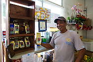 Willie Tabios with his wife Grace, the owner of The Rising Sun coffee, at their store in the village of Na'alehu in the district of Ka'u on the Big Island of Hawaii, USA, America