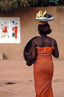 Burkina Faso, Ouagadougou, 2007. Many street vendors must move constantly to find customers.