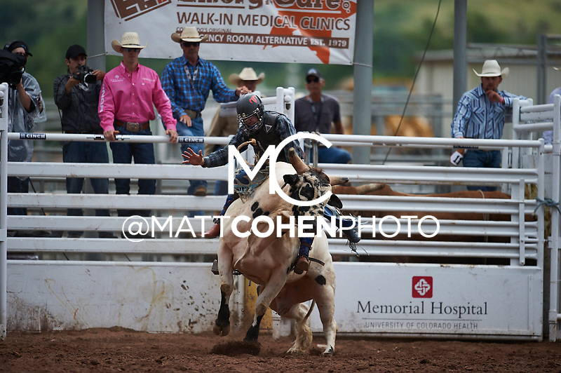 Bull rider Pistol Robinson of Hubbard, TX rides Snake Eyes at the Pikes Peak or Bust Rodeo in Colorado Springs, CO.<br /> <br /> <br /> UNEDITED LOW-RES PREVIEW<br /> <br /> <br /> File shown may be an unedited low resolution version used as a proof only. All prints are 100% guaranteed for quality. Sizes 8x10+ come with a version for personal social media. I am currently not selling downloads for commercial/brand use.