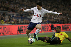 BRITAIN-LONDON-FOOTBALL-PREMIER LEAGUE-TOTTENHAM HOTSPUR VS WATFORD.(180430) -- LONDON, April 30, 2018  Tottenham Hotspur's Son Heung-Min (L) competes for the ball with Watford's Christian Kabasele during the Premier League football match between Tottenham Hotspur and Watford at Wembley Stadium in London, Britain on April 30, 2018.  Tottenham Hotspur won 2-0.  FOR EDITORIAL USE ONLY. NOT FOR SALE FOR MARKETING OR ADVERTISING CAMPAIGNS. NO USE WITH UNAUTHORIZED AUDIO, VIDEO, DATA, FIXTURE LISTS, CLUB/LEAGUE LOGOS OR ''LIVE'' SERVICES. ONLINE IN-MATCH USE LIMITED TO 45 IMAGES, NO VIDEO EMULATION. NO USE IN BETTING, GAMES OR SINGLE CLUB/LEAGUE/PLAYER PUBLICATIONS. (Credit Image: © Tim Ireland/Xinhua via ZUMA Wire)