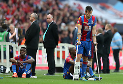 Scott Dann of Crystal Palace looks dejected on crutches after his team lose the FA Cup Final and he is left with an injury to his leg - Mandatory by-line: Robbie Stephenson/JMP - 21/05/2016 - FOOTBALL - Wembley Stadium - London, England - Crystal Palace v Manchester United - The Emirates FA Cup Final