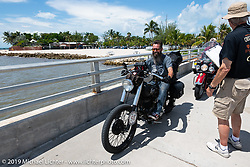 Shane Masters at the final checkpoint on his Class III 1948 Indian Chief during the Cross Country Chase motorcycle endurance run from Sault Sainte Marie, MI to Key West, FL. (for vintage bikes from 1930-1948). The staging area on a Key West pier just before the finish and near the end of the 110 mile Stage-10 ride from Miami to Key West, FL USA. Sunday, September 15, 2019. Photography ©2019 Michael Lichter.