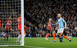 Manchester City's David Silva (right) scores his side's first goal of the game