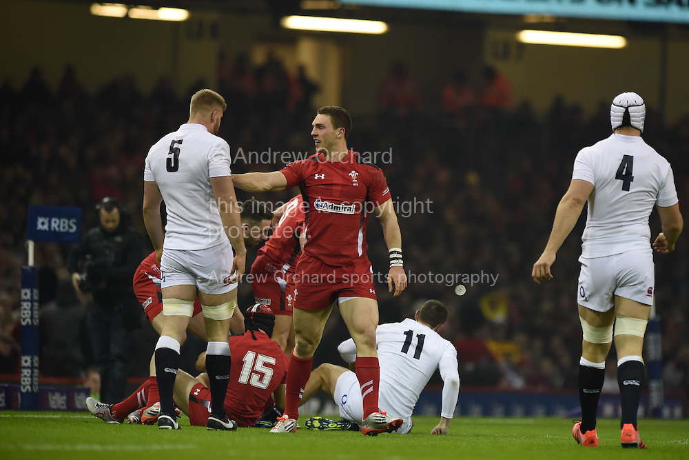 George North of Wales pushes George Kruis of England, RBS Six nations championship 2015, Wales v England at the Millennium Stadium in Cardiff, South Wales on Friday 6th  Feb 2015. pic by Andrew Orchard, Andrew Orchard sports photography.