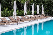 Poolside lounge chairs at an upscale resort.