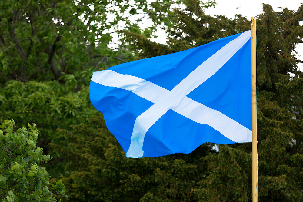 The Saltire national flag of St Andrew flying from flagpole as Scottish Referendum Independence Debate campaign and lobbying urges voters to give a YES vote for a separate nation for Scotland