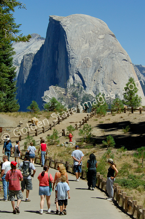 Park visitors get a first look at Half Dome from Glacier Point.