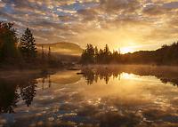 Beautiful autumn sunrise on Turtlehead Pond, Groton State Forest, Marshfield, Vermont