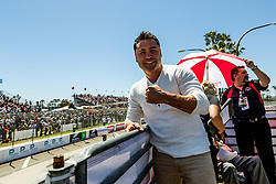 """LONG BEACH, CA - APRIL 17  Olympic gold medalist, 10-time world champion and President/Founder of Golden Boy Promotions, Oscar De La Hoya, Grand Marshal of the 2016 Toyota Grand Prix of Long Beach. Enjoys the pre-race activities before shouting """"Drivers, start your engines"""". 2016 April 17.  Byline, credit, TV usage, web usage or linkback must read SILVEXPHOTO.COM. Failure to byline correctly will incur double the agreed fee. Tel: +1 714 504 6870."""