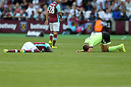 Cheikhou Kouyate of West Ham United and Simon Francis, the Bournemouth captain lay injured after clashing heads mid air. Premier league match, West Ham Utd v AFC Bournemouth at the London Stadium, Queen Elizabeth Olympic Park in London on Sunday 21st August 2016.<br /> pic by John Patrick Fletcher, Andrew Orchard sports photography.