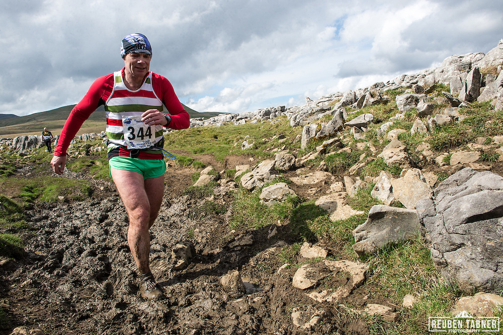 Looking for a way through the mud on the descent from Ingleborough in the Yorkshire Dales during the 60th Yorkshire Three Peaks Race.