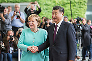 German Chancellor Angela Merkel welcomes the Chinese President Xi Jinping prior to a Joint press conference in the Chancellery in Berlin, on July 5 2017.<br /> (Photo by Omer Messinger)