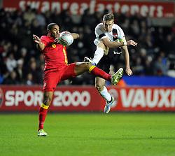 Marko Janko (Trabzonspor) of Austria  fires narrowly over under pressure from Ashley Williams (Swansea City) of Wales  - Photo mandatory by-line: Joe Meredith/JMP - Tel: Mobile: 07966 386802 06/02/2013 - SPORT - FOOTBALL - Liberty Stadium - Swansea  -  Wales V Austria - International Friendly