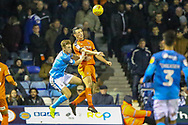 Bradford City forward Eoin Doyle (9) battles in the air with Luton Town defender Matthew Pearson (6) during the EFL Sky Bet League 1 match between Luton Town and Bradford City at Kenilworth Road, Luton, England on 27 November 2018.