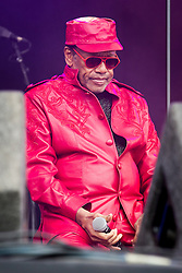 © Licensed to London News Pictures . 21/07/2013 . Suffolk , UK . Bobby Womack sits down during the other musician's solos , on the Obelisk Stage . The Latitude music and culture festival in Henham Park , Southwold . Photo credit : Joel Goodman/LNP