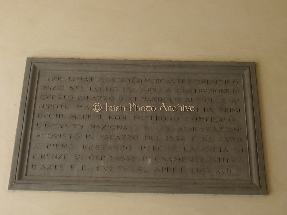 Latin inscription detail from the Palazzo Strozzi in Florence, Italy. A symmetrical palace which began construction in 1489, and was completed in 1538. Commissioned for construction by Filippo Strozzi the Elder. Rusticated stone and beautiful archways are features of this building.