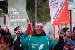 6 December 2019, Madrid, Spain: Faith-based participants from the Lutheran World Federation, the World Council of Churches and the ACT Alliance join in as thousands upon thousands of people march through the streets of central Madrid as part of a public contribution to the United Nations climate meeting COP25, urging decision-makers to take action for climate justice. Here, Lutheran World Federation delegate and council member Khulekani Sizwe Magwaza from the Evangelical Lutheran Church in South Africa.