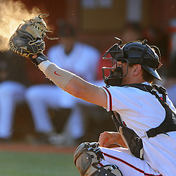 Rutgers catcher Jeff Melillo (#1) catches a high pitch during Rutgers' 12-11 walk-off home run victory over Princeton in NCAA college baseball at Bainton Field in Piscataway, N.J.