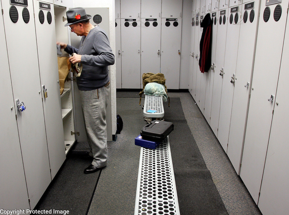 Retiring Watsonville Police Chief Terry Medina empties out his locker at the end of his final day at the department, leaving behind a legacy of two decades of bridge building and good police work.<br /> Photo by Shmuel Thaler <br /> shmuel_thaler@yahoo.com www.shmuelthaler.com