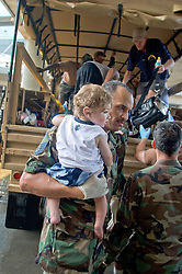 30 August, 2005. New Orleans Louisiana. Hurricane Katrina aftermath. <br /> A young child is brought to the makeshift hospital triage unit set up at the Superdome in New Orleans. <br /> Photo Credit: Charlie Varley/varleypix.com