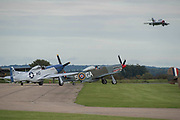 P50 Mustangs taxi out to the runway - Duxford Battle of Britain Air Show taking place during IWM (Imperial War Museum) Duxford's centenary year. Duxford's principle role as a Second World War fighter station is celebrated at the Battle of Britain Air Show by more than 40 historic aircraft taking to the skies.