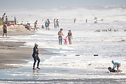 Folly Beach, South Carolina, USA. 03 September 2019. Beach goers ignore the mandatory evacuation order and crowd the washout as waves roll in ahead of Hurricane Dorian September 3, 2019 in Folly Beach, South Carolina. The slow moving monster storm devastated the Bahamas and is expected to reach Charleston as a Category 2 by Thursday morning.
