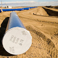 122412       Brian Leddy<br /> Water pipe lays ready to be connected and buried near Twin Lakes Monday. The pipe is part of the Navajo-Gallup Pipeline project.