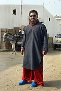 Yousuf Bashir Qureshi photographed at his Commune gallery in the docks area of karachi.