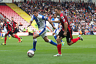 Marc Pugh (R) of AFC Bournemouth goes past Lee Williamson (L) of Blackburn Rovers during the Skybet Championship match, AFC Bournemouth v Blackburn Rovers at The Goldsands Stadium in Bournemouth, England on Saturday 28th September 2013. Picture by Sophie Elbourn/Andrew Orchard Sports Photography.