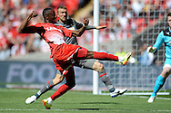 Leyton Orient's Moses Odubajo striking the ball . Skybet football league one play off final match , Leyton Orient  v Rotherham Utd at Wembley Stadium in  London on Sunday 25th May 2014.<br /> pic by John Patrick Fletcher, Andrew Orchard sports photography.
