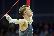 Jay Thompson of Great Britain on the horizontal bar celebrates during the The Superstars of Gymnastics event at the O2 Arena, London, United Kingdom on 23 March 2019.