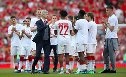 Arsenal manager Arsene Wenger with players on the pitch after the final whistle