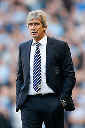 Manager Manuel Pellegrini of Manchester City looks on - Photo mandatory by-line: Rogan Thomson/JMP - 07966 386802 - 21/08/2014 - SPORT - FOOTBALL - Manchester, England - Etihad Stadium - Manchester City v Chelsea FC - Barclays Premier League.