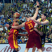 Fenerbahce's Darjus LAVRINOVIC (R) and Galatasaray CC's Preston SHUMPERT (L) during their Turkish Basketball Legague Play-Off final fifth match Fenerbahce between Galatasaray at the Sinan Erdem Arena in Istanbul Turkey on Tuesday 14 June 2011. Photo by TURKPIX