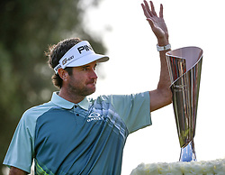 Bubba Watson waves in front of the winner's trophy after winning the PGA Tour Genesis Open golf tournament at Riviera Country Club in the Pacific Palisades area of Los Angeles, the United States Sunday, February 18, 2018. Watson won the Genesis Open. (Credit Image: © Zhao Hanrong/Xinhua via ZUMA Wire)