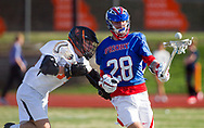 Priory's Murphy Reese tries to keep control of the ball during a lacrosse match on Tuesday, April 2, 2019, at Moss Field in Webster Grvoes, Mo.  Priory won 9-7. Gordon Radford   Special to STLhighschoolsports.com