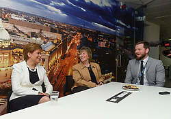 Pictured: Nicola Sturgeon met with university worker Lukas Olech from Poland (right) and University Human Resources Director Christine Barr (left)<br /> <br /> SNP leader Nicola Sturgeon met workers at Glasgow University from the EU ahead of next week's European elections.<br /> <br /> © Dave Johnston / EEm