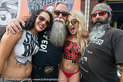 """Harry Fryed of the Fryed Brothers Band with Steve """"Beatnik"""" Werner and some painted ladies before their performance at the Knuckle Saloon during the 75th Annual Sturgis Black Hills Motorcycle Rally.  SD, USA.  August 7, 2015.  Photography ©2015 Michael Lichter."""