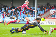 Matthew Lund of Scunthorpe United (7) and Jermaine Anderson of Bradford City (18) in action during the EFL Sky Bet League 1 match between Scunthorpe United and Bradford City at Glanford Park, Scunthorpe, England on 27 April 2019.