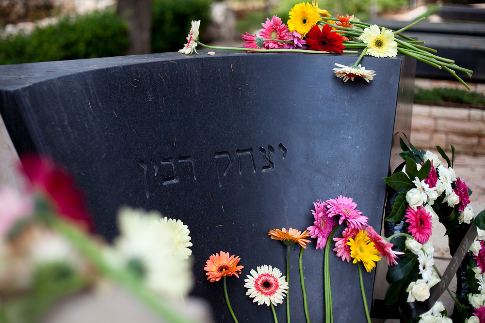 Flowers are seen on the grave of assassinated Israeli prime minister Yitzhak Rabin following a memorial ceremony marking the 16th anniversary of Rabin's assassination at the Mount Herzl Military cemetery in Jerusalem, Israel, on November 4, 2011. Rabin was shot and killed by right-wing Jewish activist Yigal Amir on November 4, 1995.