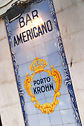 sign outside bar: bar americano porto krohn lisbon portugal
