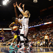 Nneka Ogwumike, Los Angeles Sparks, (wearing face mask), is defended by sister Chiney Ogwumike, (centre) and Katie Douglas, Connecticut Sun, during the Connecticut Sun Vs Los Angeles Sparks WNBA regular season game at Mohegan Sun Arena, Uncasville, Connecticut, USA. 3rd July 2014. Photo Tim Clayton
