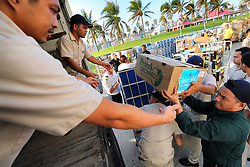 Hurricane Dorian food relief boxes are loaded onto trucks after arriving from the Royal Caribbean's Mariner of the Seas ship in Freeport, Bahamas, Saturday, September 7, 2019. The ship delivered 10,000 meals and thousands of cases of bottled water to Freeport, Bahamas, early Saturday morning. Photo by Joe Burbank/Orlando Sentinel/TNS/ABACAPRESS.COM