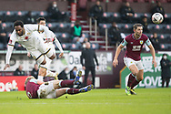 Milton Keynes Dons forward Cameron Jerome (35) fouled by Burnley defender Ben Mee (6) during the FA Cup match between Burnley and Milton Keynes Dons at Turf Moor, Burnley, England on 9 January 2021.