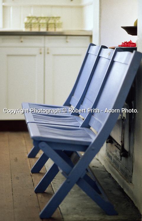 three blue kitchen chairs.