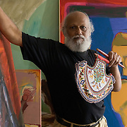 Artist Jatin Das (born December 2nd, 1941) at his studio in New Delhi holding one of his fan. His collection of fans from all over the world counts more than 6,500 samples and has been exhibited all over the world. August 2008
